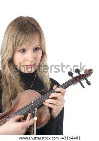 Portrait of beautiful young female violinist over white background - stock photo