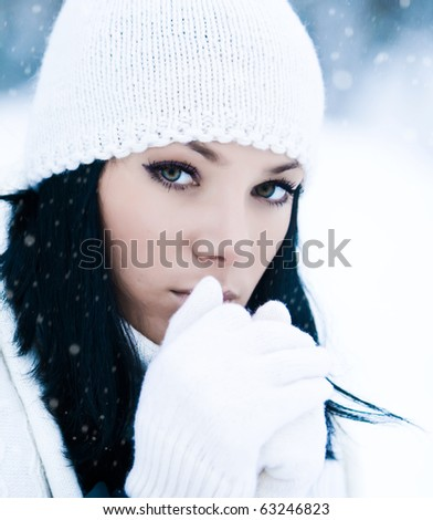 Portrait of beautiful young girl in winter day - stock photo