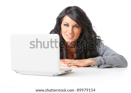 Portrait of beautiful young girl laying on the floor using a laptop over white background. Isolated - stock photo