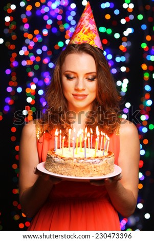 Portrait of beautiful young girl on bright lights background - stock photo