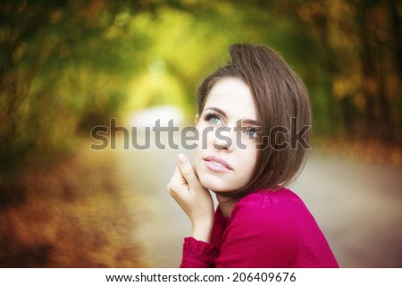 Portrait of beautiful young girl on nature.