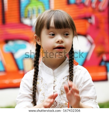 Portrait of beautiful young girl on the playground. - stock photo
