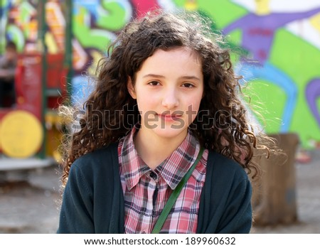 Portrait of beautiful young girl on the playground . - stock photo