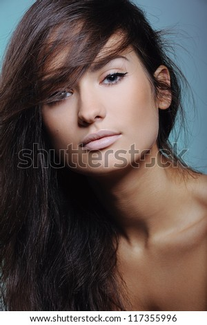 portrait of beautiful young girl with clean skin in color paint - stock photo