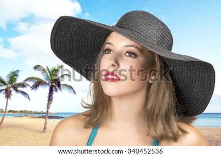 Portrait of beautiful young girl with clean skin on pretty face - beach background - stock photo