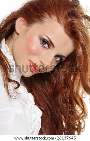 Portrait of beautiful young girl with gorgeous red hair and stylish makeup