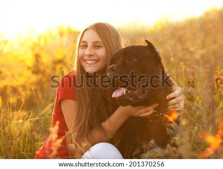 portrait of Beautiful young girl with her dog Cane Corso
