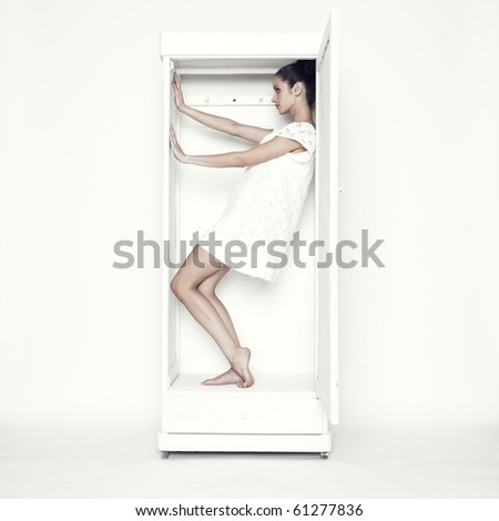 Portrait of beautiful young girl with her wardrobe - stock photo
