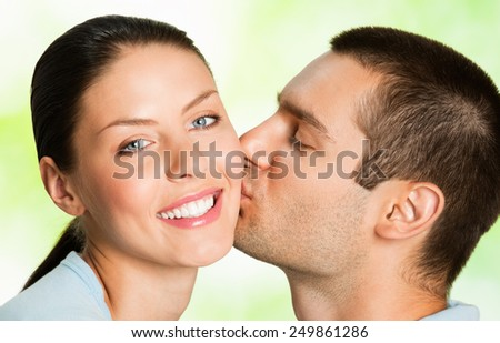 Portrait of beautiful young happy smiling carefree couple, outdoor - stock photo