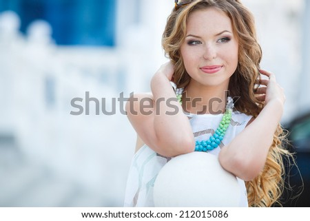 Portrait of beautiful young happy smiling woman, outdoors.  - stock photo