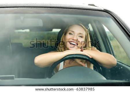 portrait of beautiful young happy woman in the new car  - outdoors - stock photo