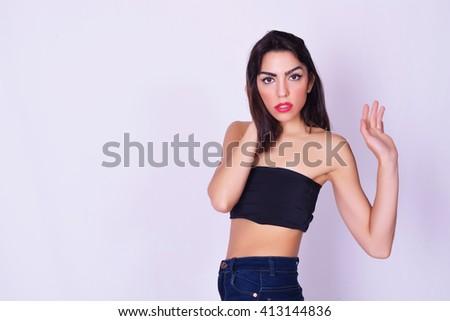 Portrait of beautiful young hispanic / caucasian woman, isolated over grey background. Feminine style. - stock photo