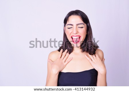 Portrait of beautiful young hispanic / caucasian woman, isolated over grey background. Feminine style. Young woman doing expressions. - stock photo
