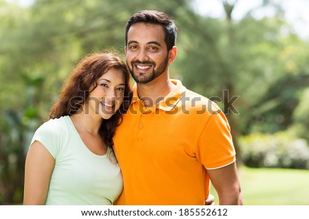 portrait of beautiful young indian couple outdoors - stock photo