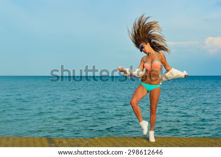 Portrait of beautiful young lady enjoying dancing over outdoors copy space background - stock photo