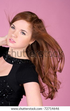 Portrait of beautiful young lady in black dress - stock photo