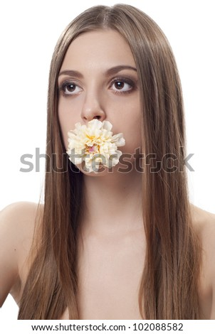 Portrait of beautiful young lady with flower in her mouth over white - stock photo