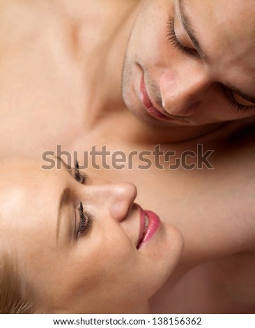 portrait of beautiful young lovers man and woman - stock photo