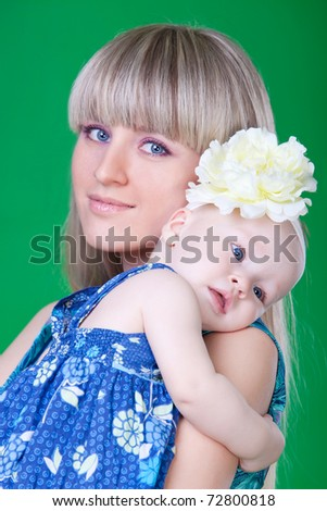 Portrait of beautiful young mum embracing her little daughter