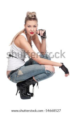 Portrait of beautiful young playful rock girl. Isolated on white - stock photo