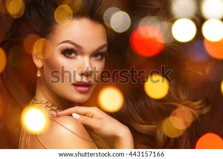 Portrait of beautiful young sexy woman with jewelry, over light background