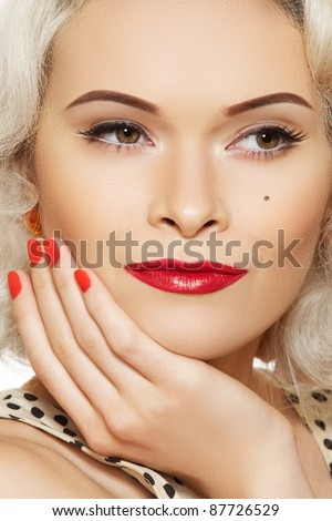 Portrait of beautiful young sexy woman with vintage make-up and hairstyle. Pin-up girl. American style. Happy female face - stock photo