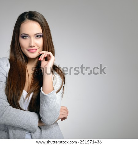 portrait of beautiful young smiling woman indoor - stock photo