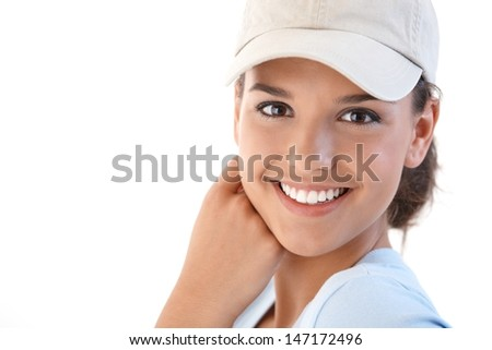 Portrait of beautiful young smiling woman, looking at camera. - stock photo