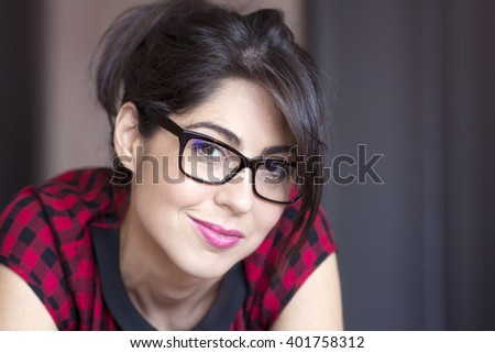 Portrait of beautiful young smiling woman with modern eyeglasses with black frame - stock photo