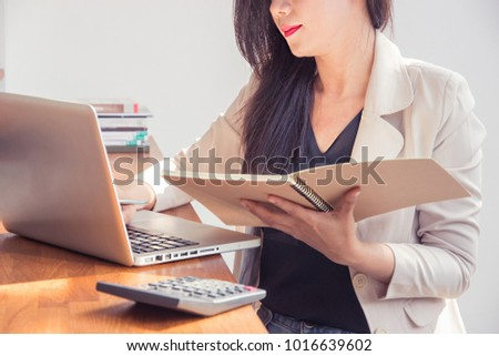 Portrait of beautiful young woman asian working in the office.Business concept. Film effect and sun glare effect
