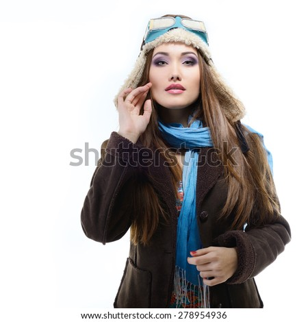 portrait of beautiful young woman aviator, over white - stock photo