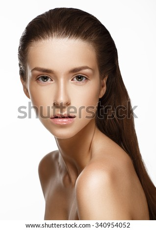 Portrait of Beautiful Young Woman. Beauty Girl. Fresh Clean Skin. Isolated on white background. - stock photo