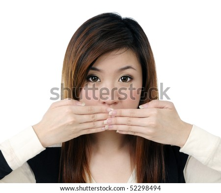 Portrait of beautiful young woman covering her mouth with both hands over white background. - stock photo