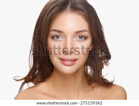 Portrait of beautiful young woman face. Isolated on white background. - stock photo