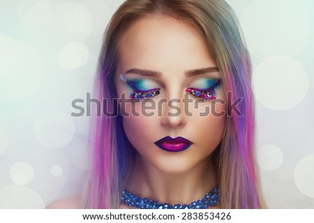 Portrait of beautiful young woman, girl, woman, singer, model, star, celebrity, mermaid. White background. Bright creative makeup, perfect eyebrows, expressive eyes, violet, blue. Hair, color strands - stock photo