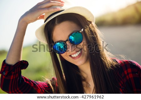 Portrait of beautiful young woman hiker walking on the road. - stock photo