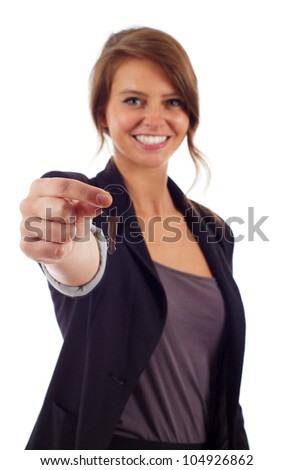 Portrait of beautiful young woman holding key isolated over white background - stock photo