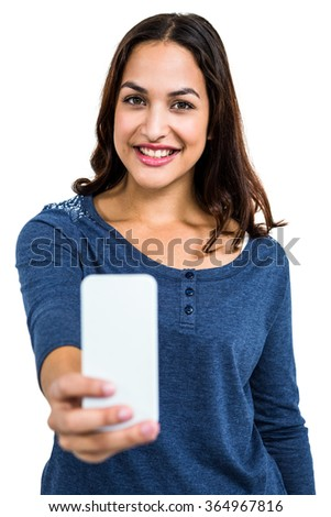 Portrait of beautiful young woman holding mobile phone against white background