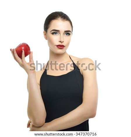 Portrait of beautiful young woman holding red apple near her face over white background - stock photo