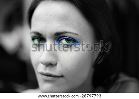 Portrait of beautiful young woman in Black and White with selective color for eyes