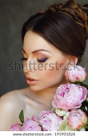 Portrait of Beautiful Young Woman in Flowers. Healthy Long Hair And Clean Skin