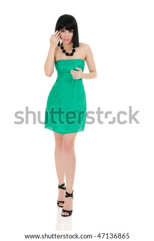 Portrait of beautiful young woman in mini dress isolated on white background