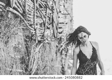 Portrait of beautiful young woman in underwear in a forest - stock photo