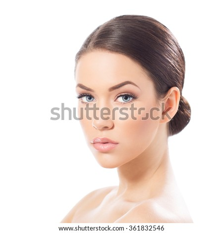 Portrait of beautiful young woman looking at camera, isolated on white - stock photo