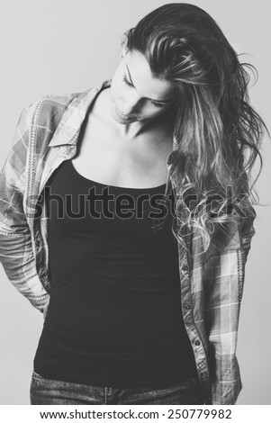 Portrait of beautiful young woman, model of fashion, wearing casual clothes. Studio shot - stock photo