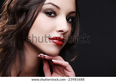 Portrait of beautiful young woman on black background. - stock photo