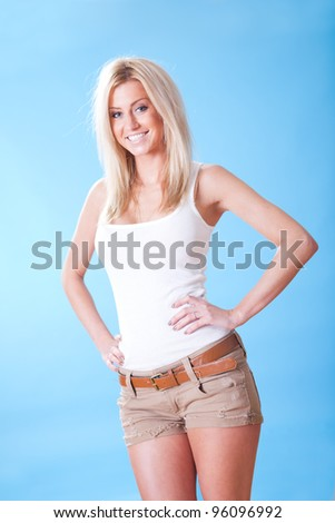 Portrait of beautiful young woman on sky background - stock photo