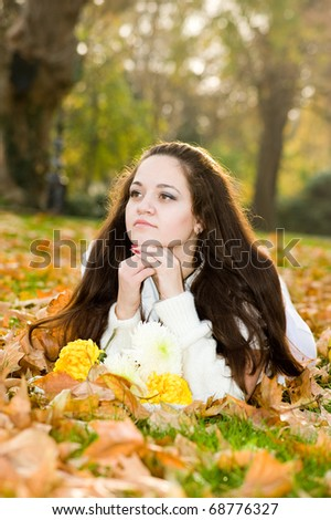 Portrait of beautiful young woman outdoors