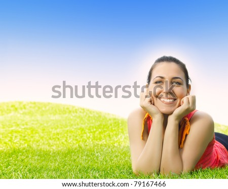 Portrait of beautiful young woman relaxing outdoors. - stock photo