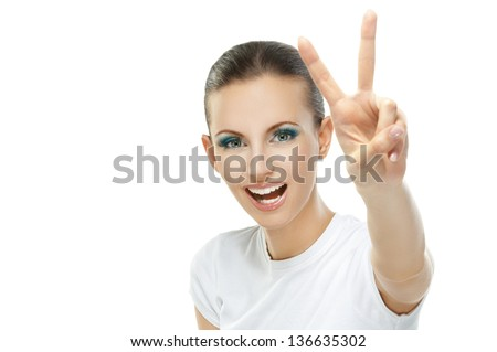 Portrait of beautiful young woman showing sing victory, isolated on white background. - stock photo